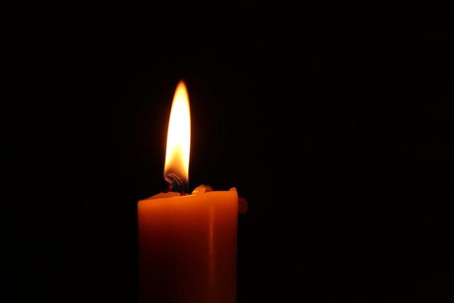flickering candle in a dark room